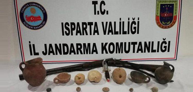 Konya'dan Isparta'ya satış için gelen iki tarihi eser kaçakçısı yakalandı